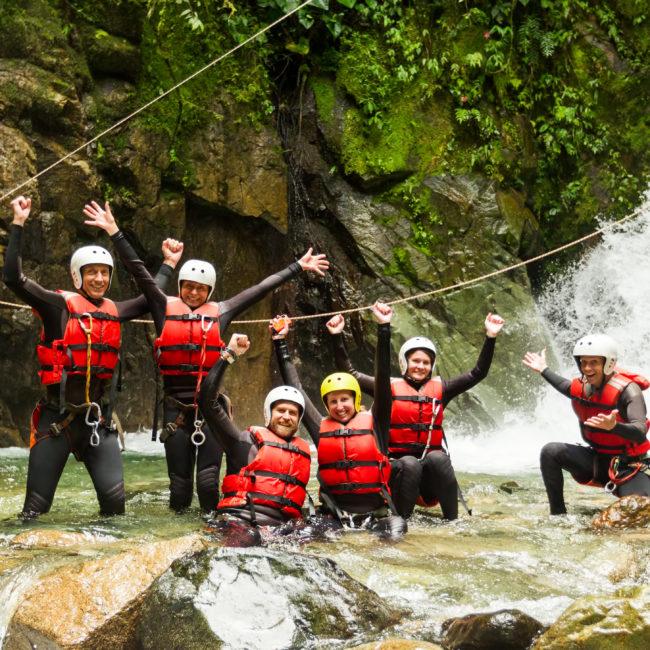 Group Of People Having Fun During A Canyoning Expedition In Llanganates National Park Ecuador